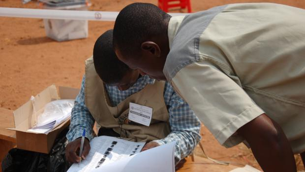 Checking for the names of a voter by the presiding official